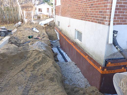 Remplacement de drain les pros du drainage - Drainage maison en pierre ...